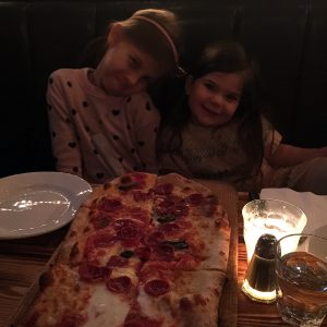 2 girls and their pizza