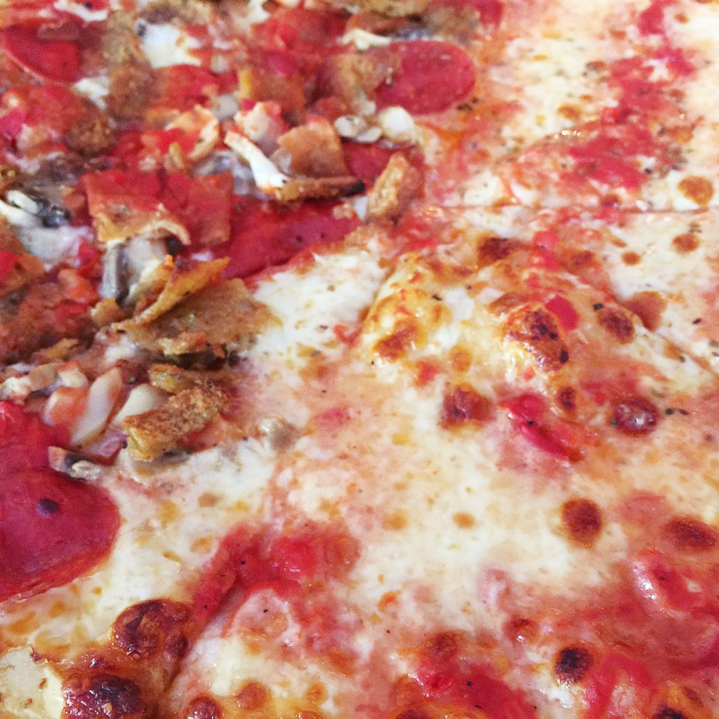 Pizza toppings split by the half - everyone's a winner!